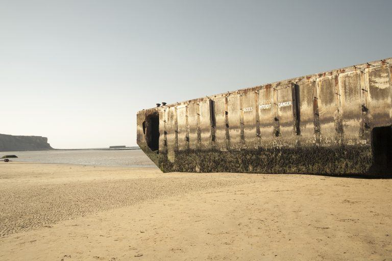 Remains of Mulberry Artificial Harbour from D-Day invasion, Gold Beach, Arromanches-les-Bains, Normandy, France - September 21, 2010.
