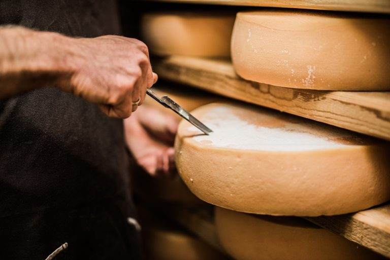 Frenchman taking a sample of premium quality cheese