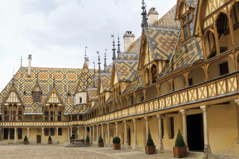 """""""Polychromic glazed-tile roof of the Hospices de Beaune - a charitable institution built in the XVth century. These four color tiles became characteristic for the Burgundy architecture. Burgundy, France."""""""
