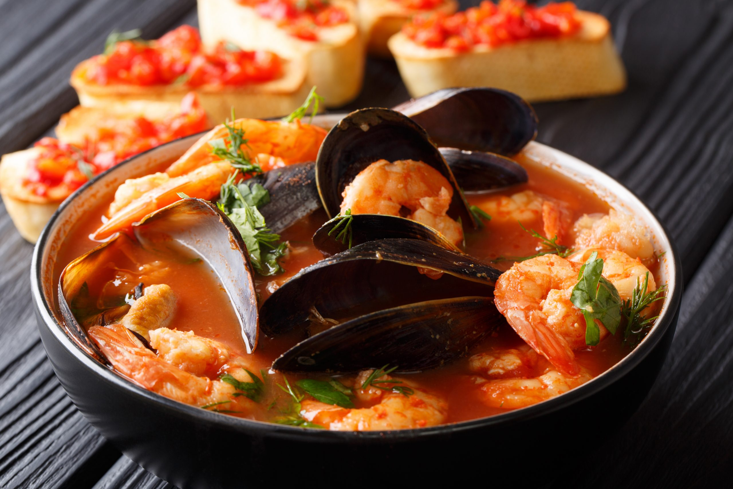 French,Seafood,Bouillabaisse,Soup,Closeup,In,A,Bowl,Served,With